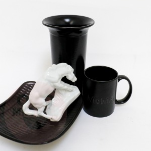 The Thirsty Stallion Drinks from a MOMA Mug