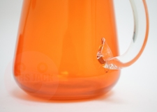 Orange glass decanter is invisible but unfortunately chipped at the handle